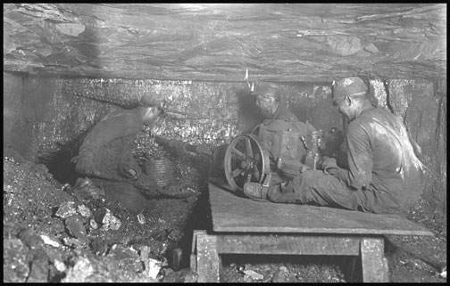 Man digging coal by machinery - Brown Mine - West Virginia - 1908